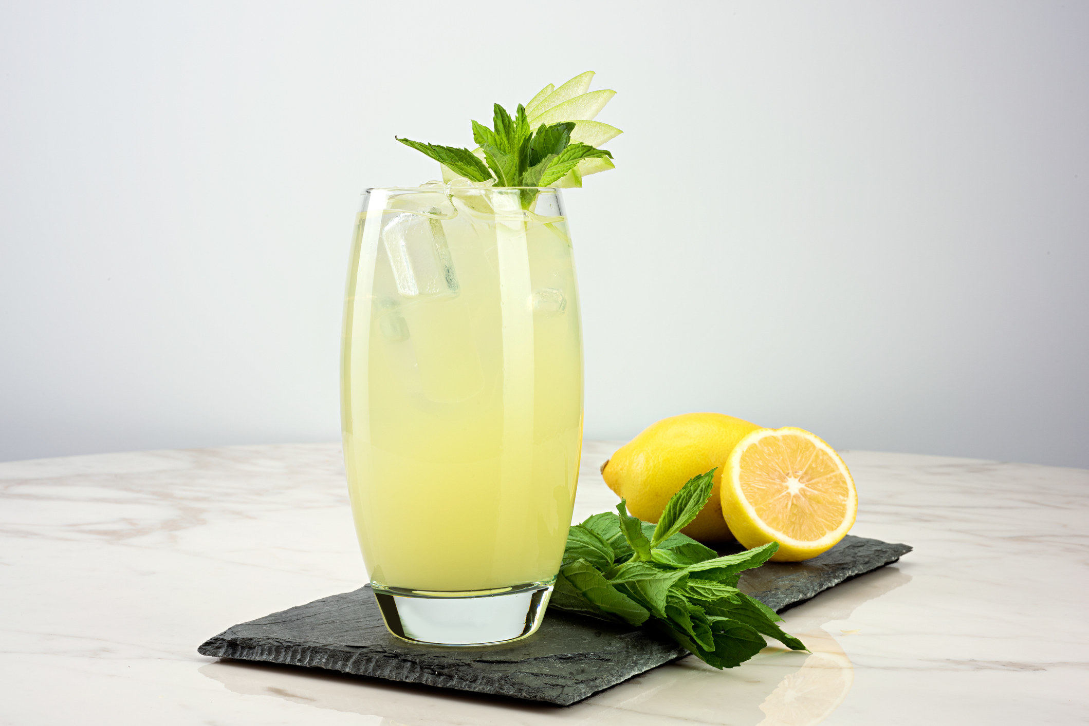 A glass of lemonade with mint.