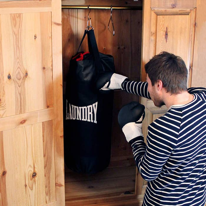 A person punching the filled bag