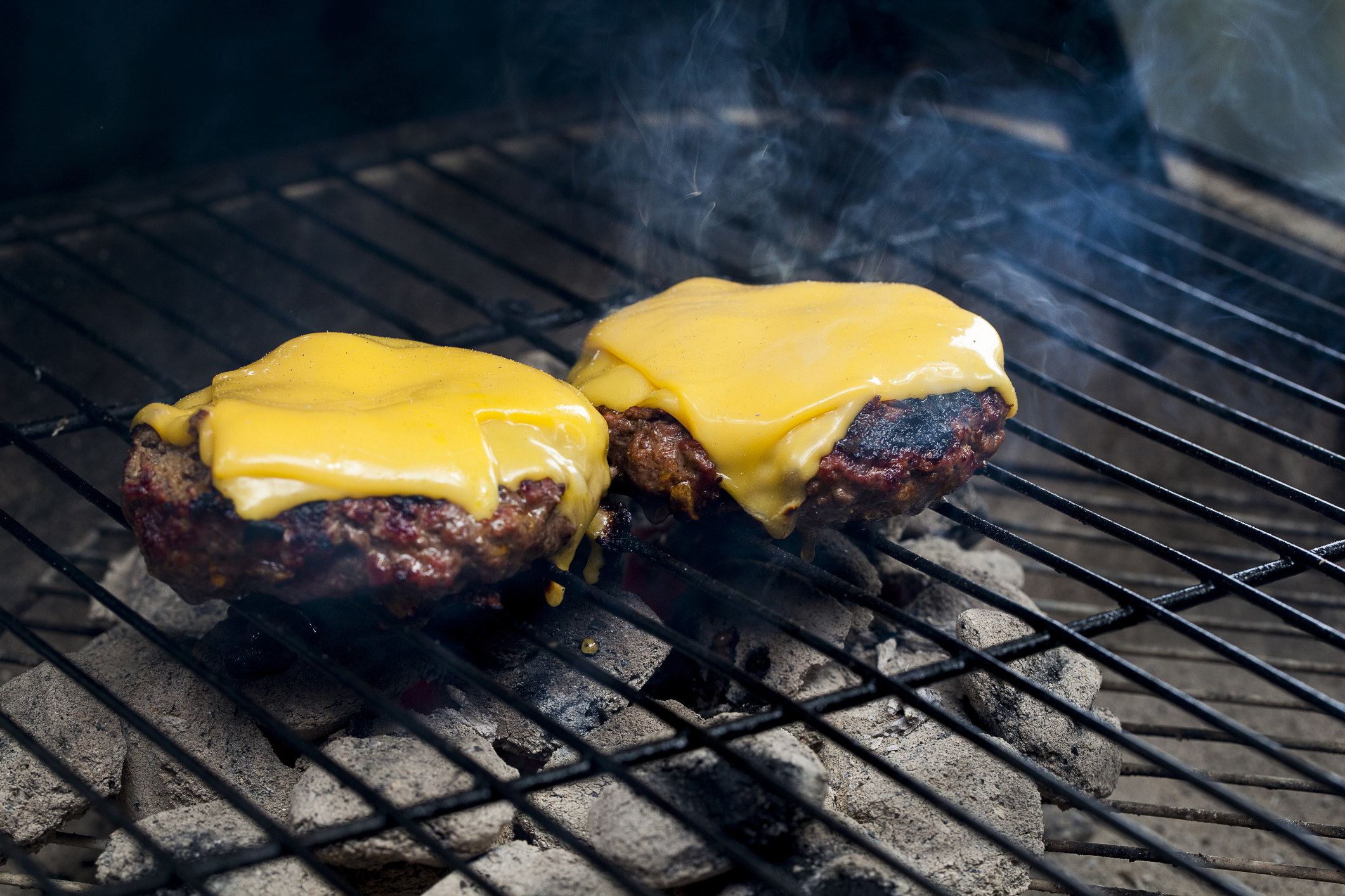 Burger patties topped with American cheese.