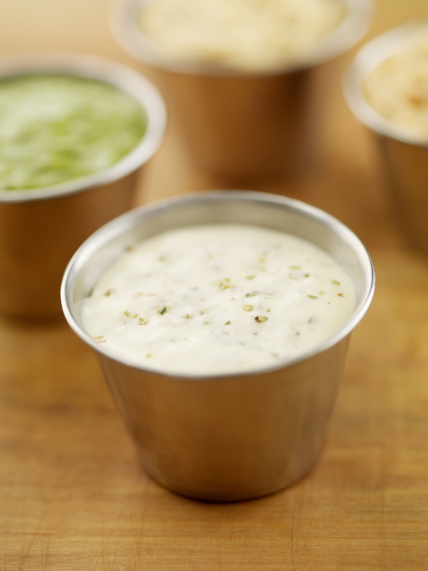 A cup of ranch dressing.