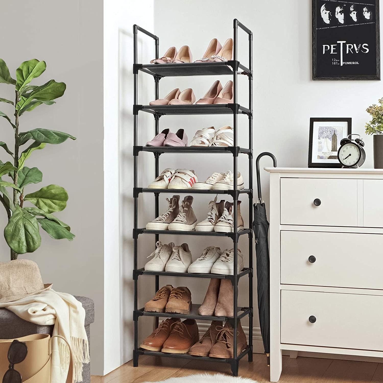 A tall shoe rack next to a dresser