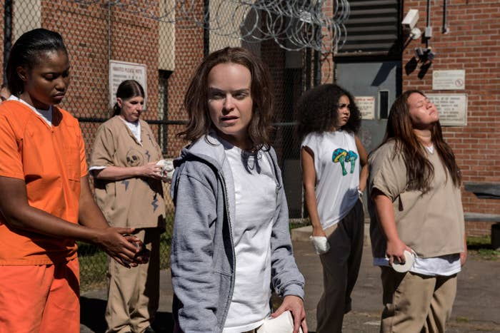"""Taryn Manning stands in a prison courtyard on set of """"Orange Is The New Black,"""" Season 5"""