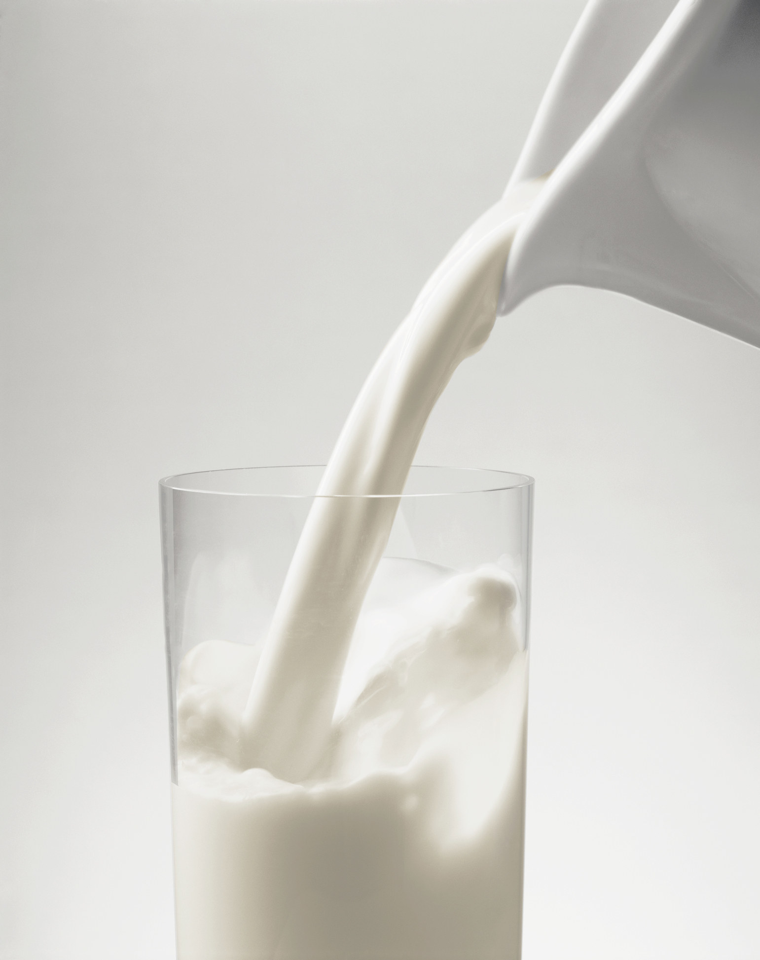 Pouring milk into a glass.