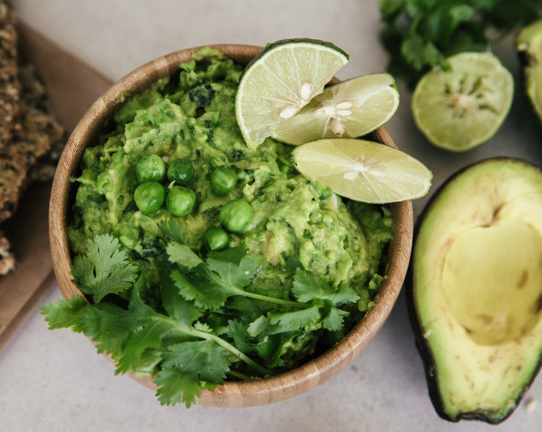 A bowl of guacamole with cilantro.