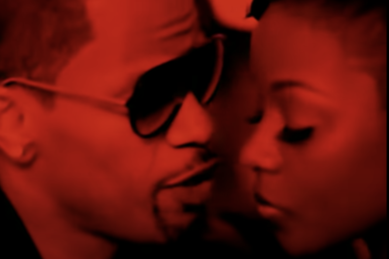 Jamie Foxx leaning in towards a girl's face