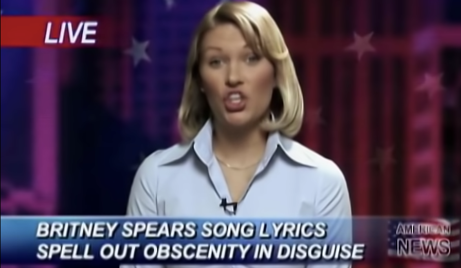 """fake news reporter with the footer """"Britney Spears song lyrics spell out obscenity in disguise"""" in the music video for the song"""