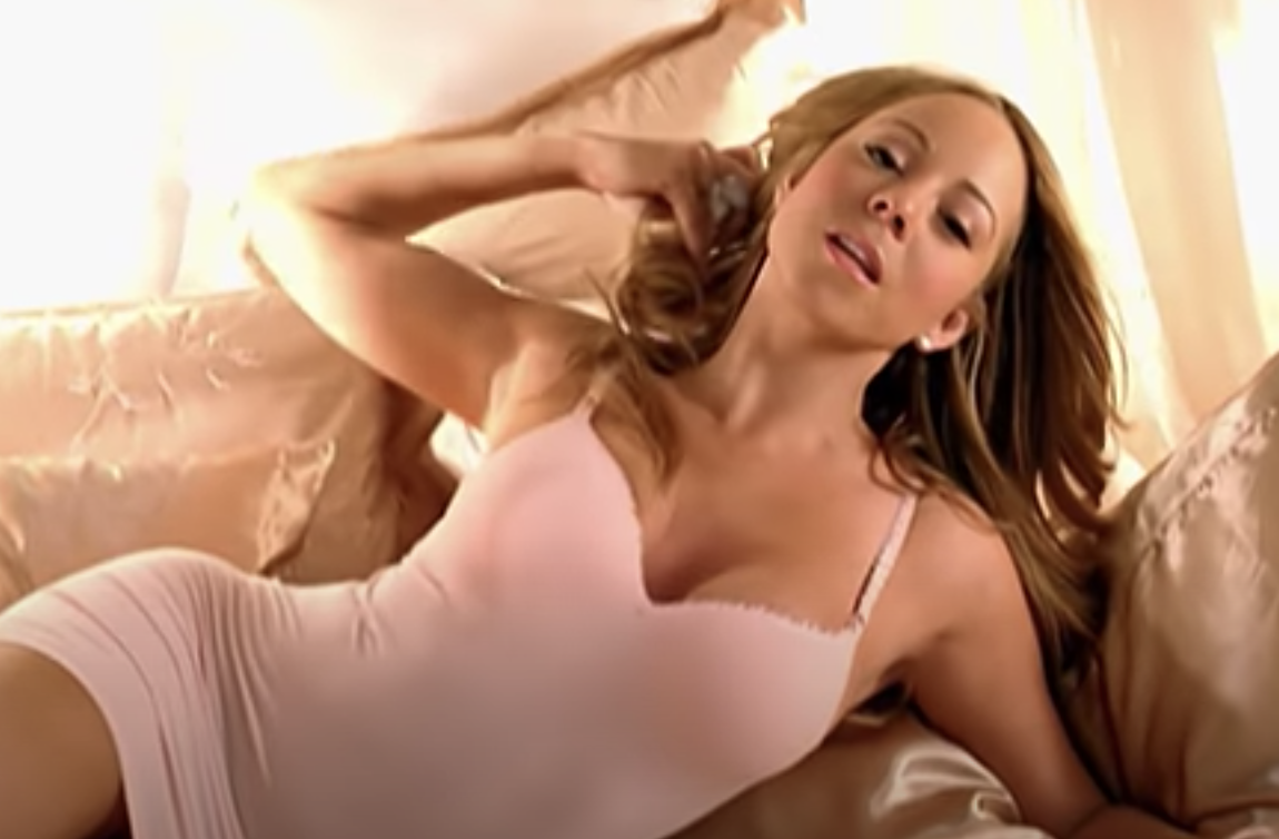 Mariah lying on a bed