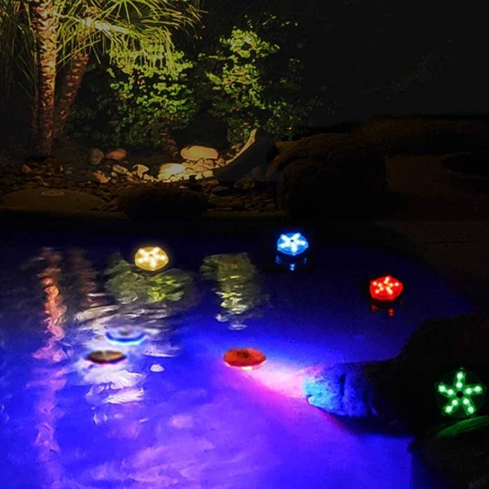 a group of pool lights in some water