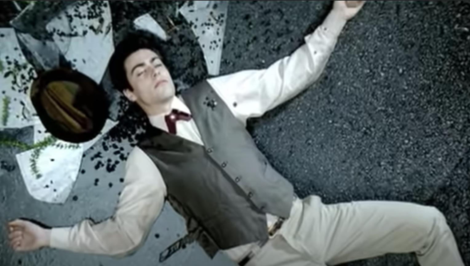 man lying dead on the street