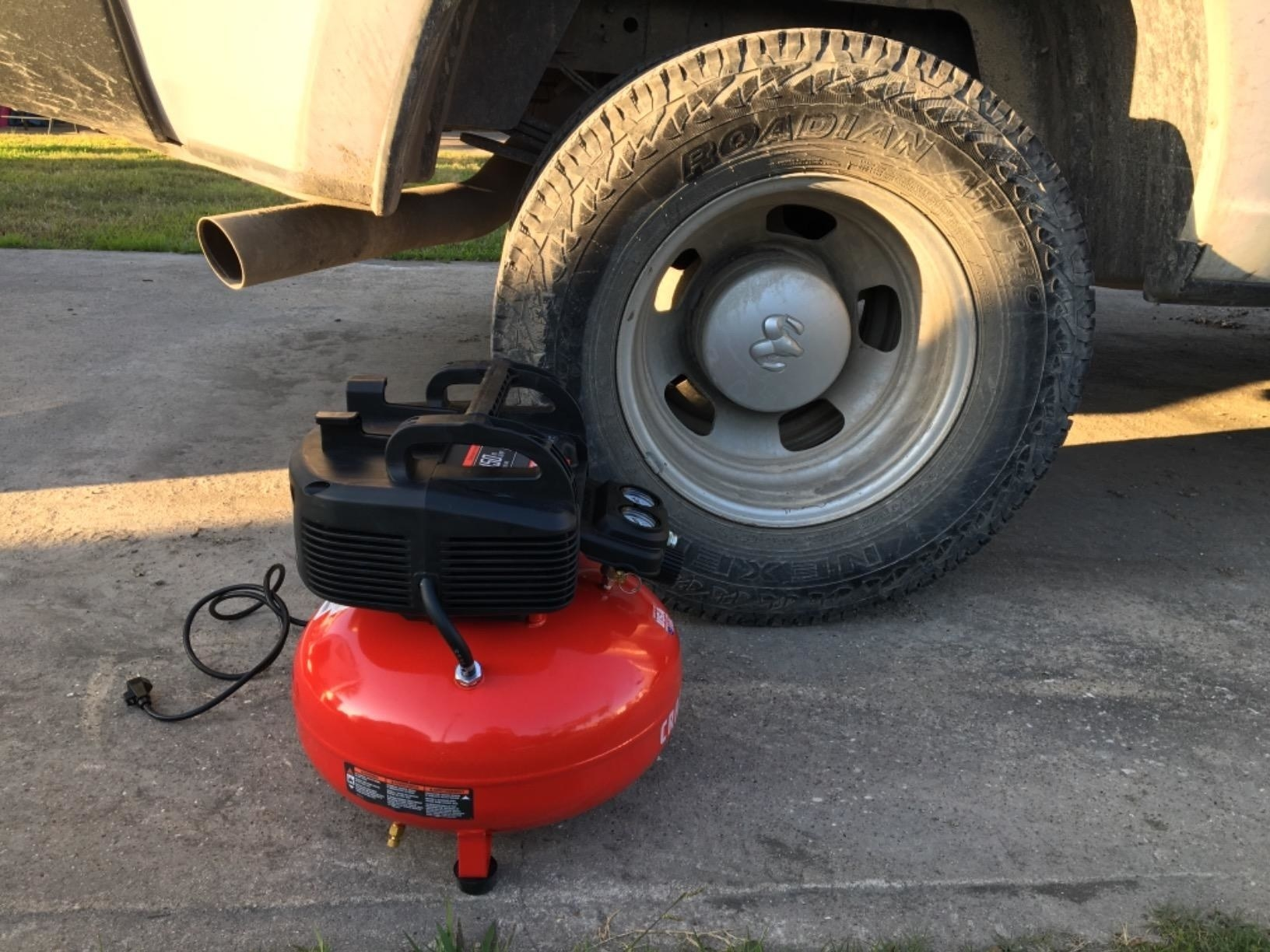 The compressor next to an RV tire