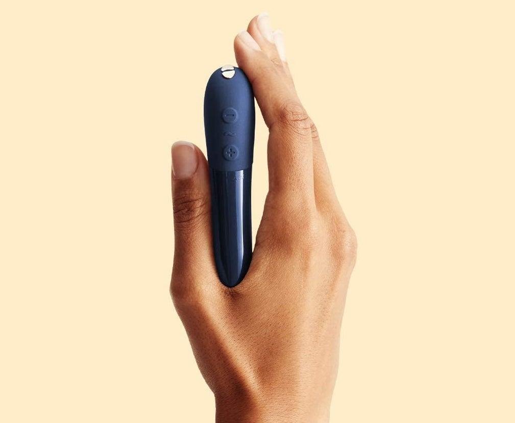 Model holding blue bullet vibrator