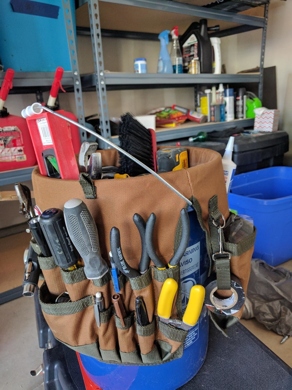 The bucket loaded with tools in the many pockets