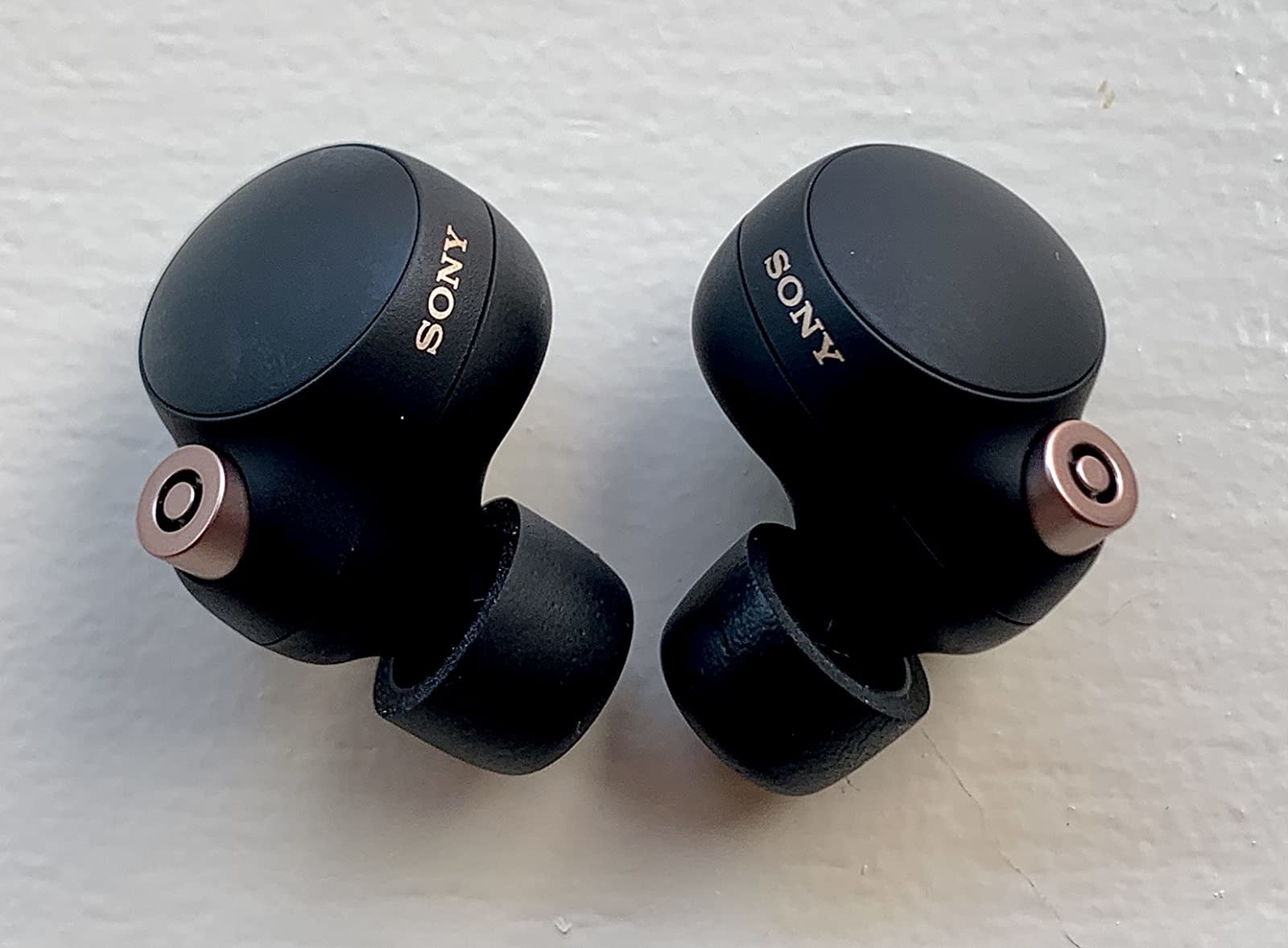 a reviewer photo of the earbuds in black