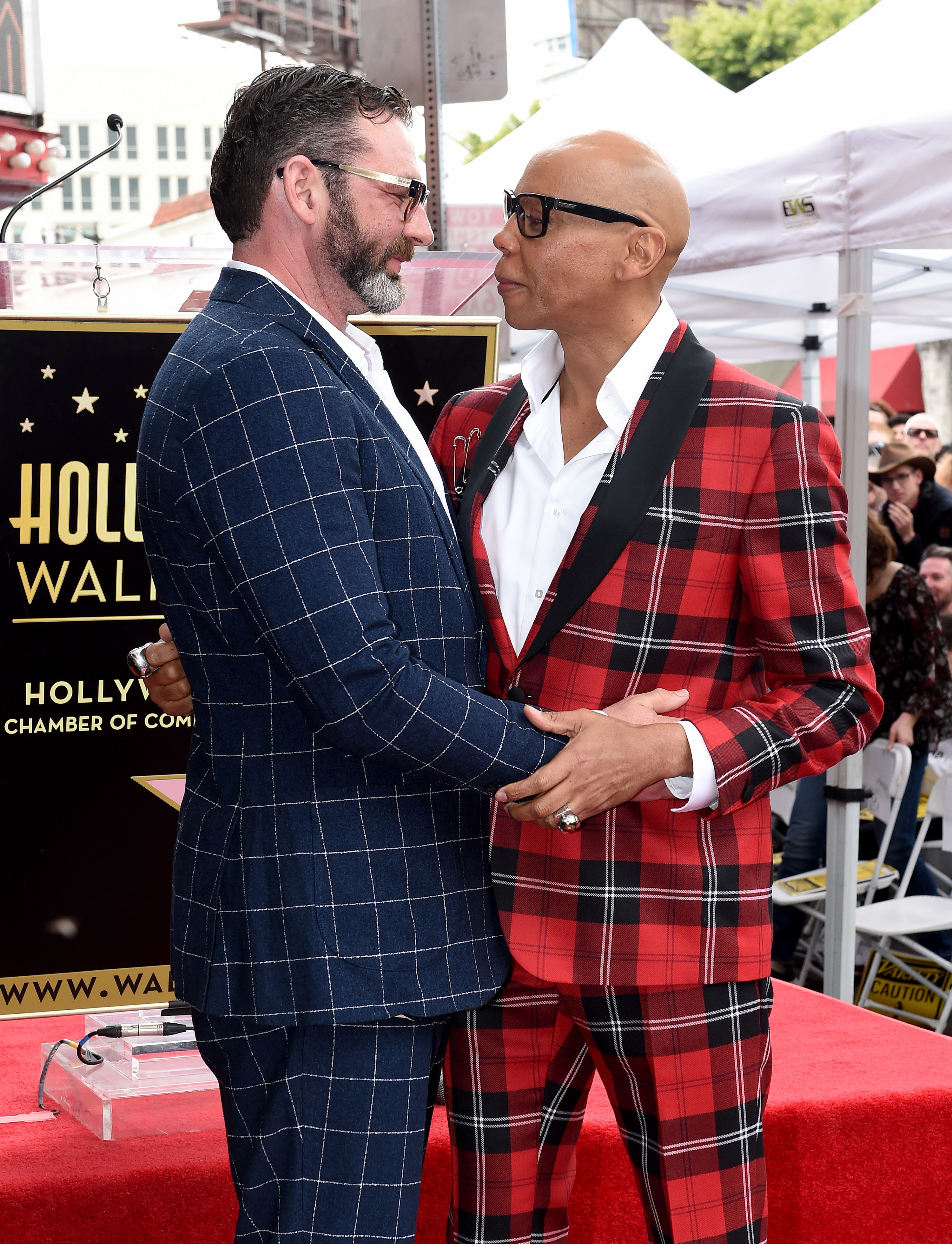 Georges and RuPaul hugging on a red carpet