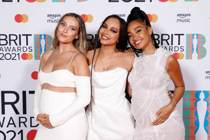 Leigh-Anne Pinnock, Jade Thirlwall and Perrie Edwards of Little Mix pose in the media room during The BRIT Awards 2021 at The O2 Arena on May 11, 2021 in London, England