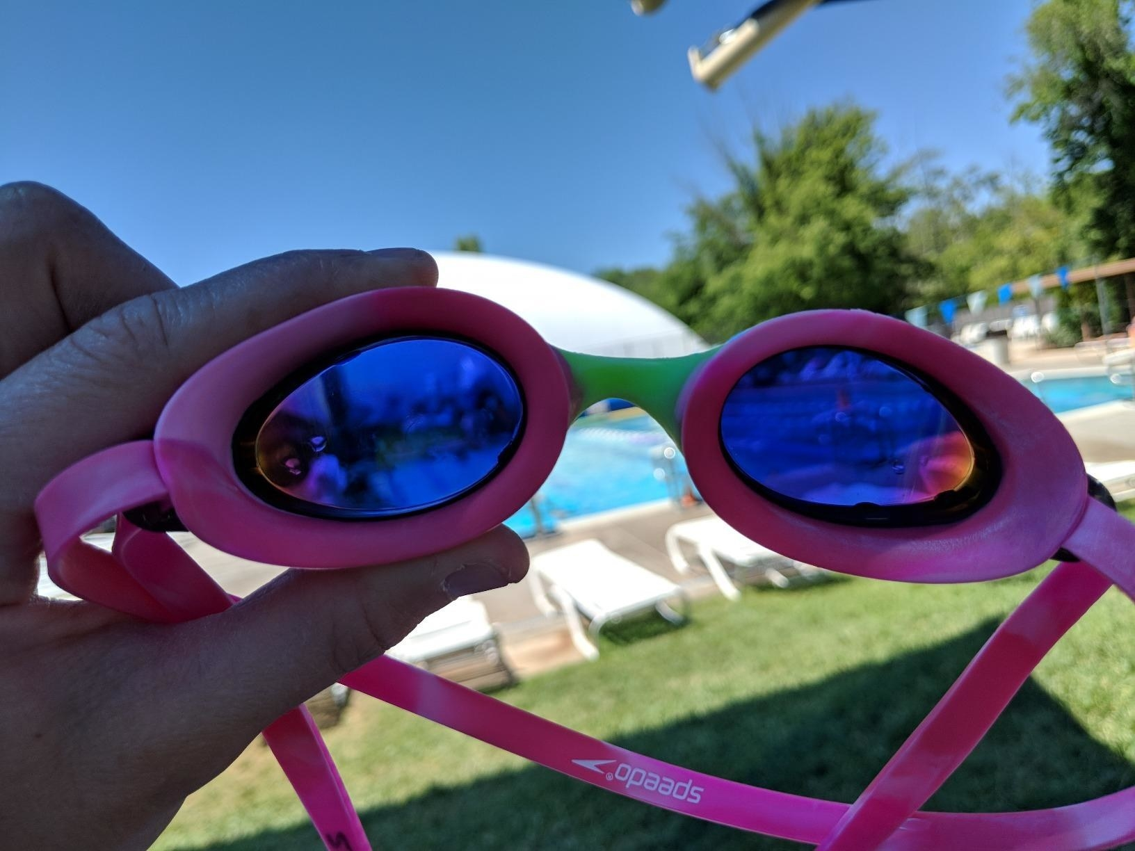 A reviewer demonstrates the tint on the pink goggles