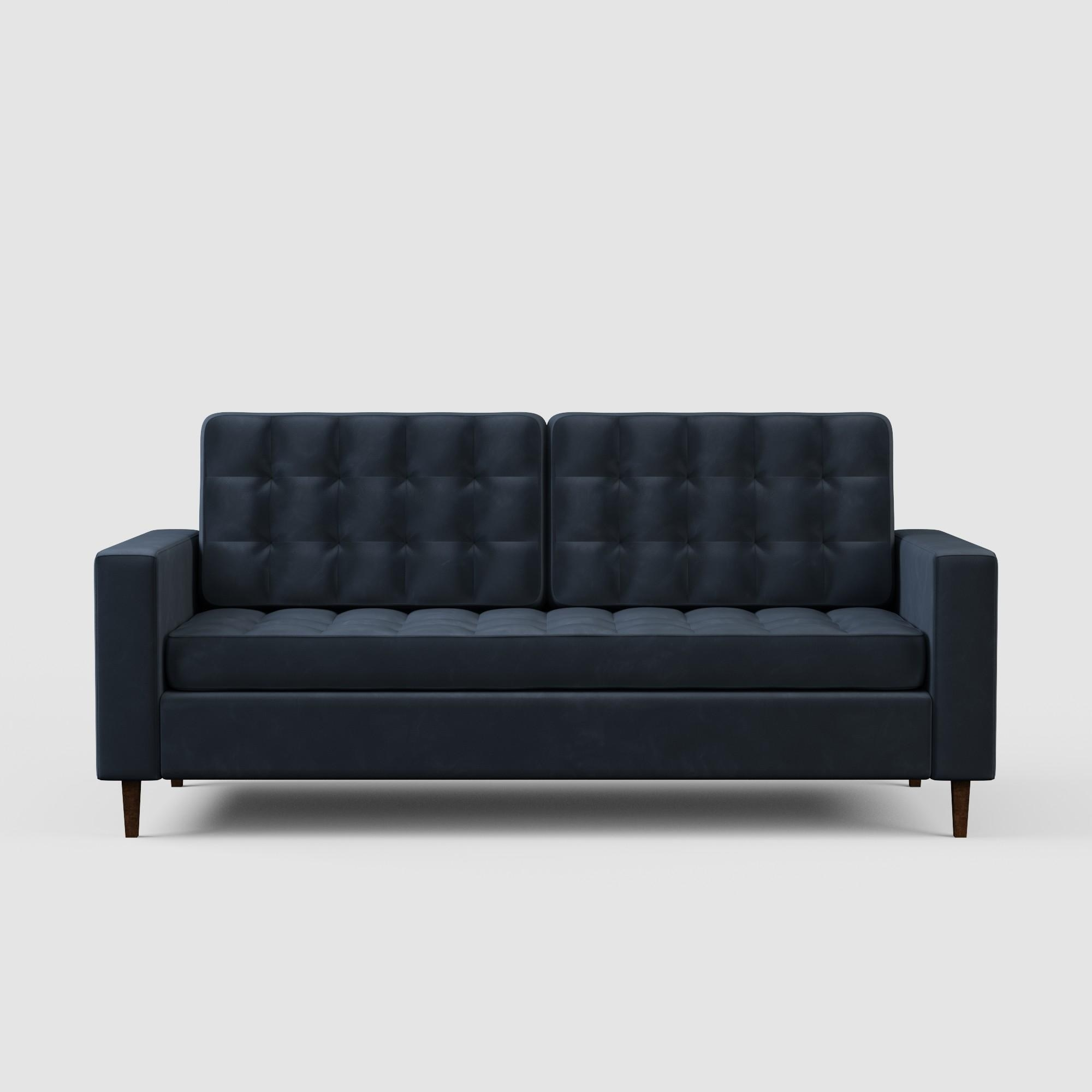 The sofa with buttonless tufting on each cushion and square arms