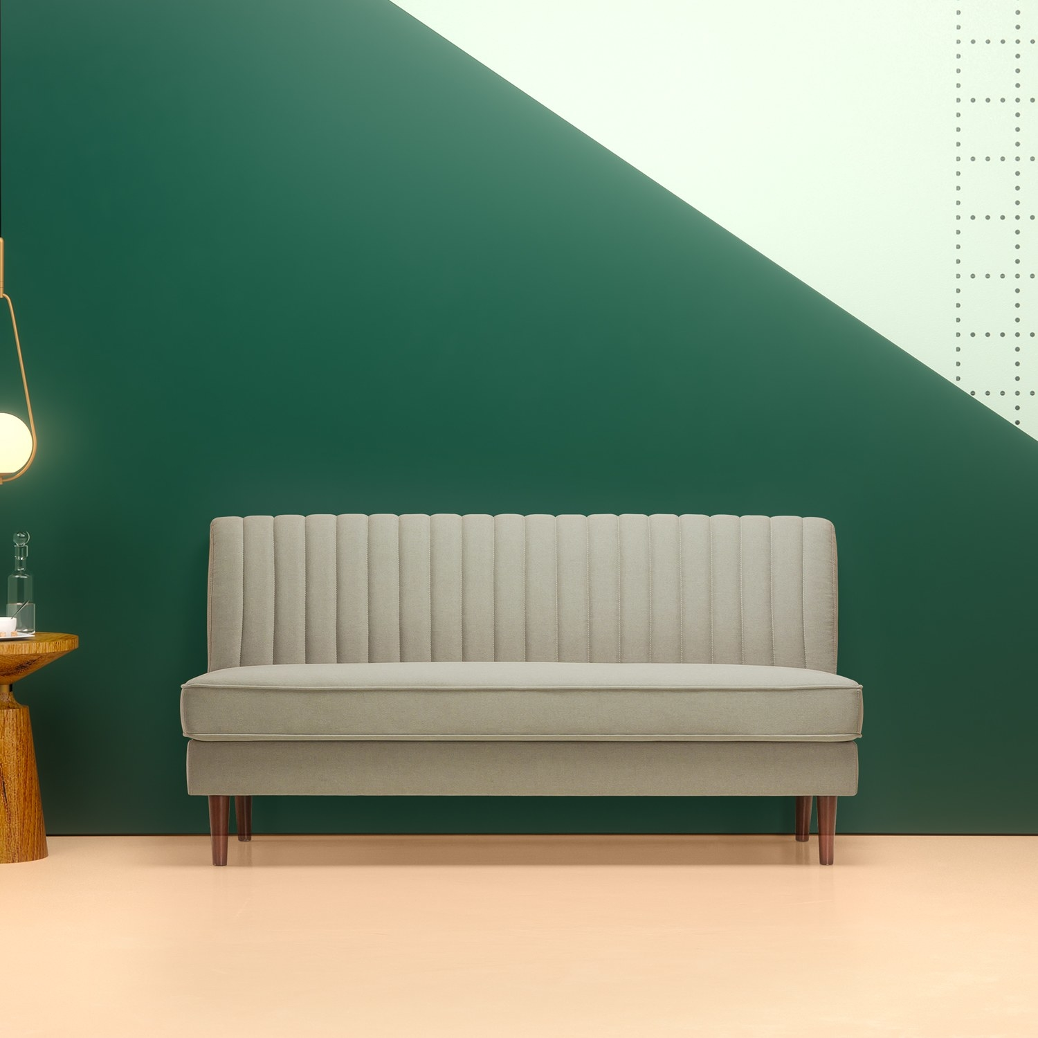 The armless beige sofa with dark wooden legs and a vertical line pattern on the back cushion