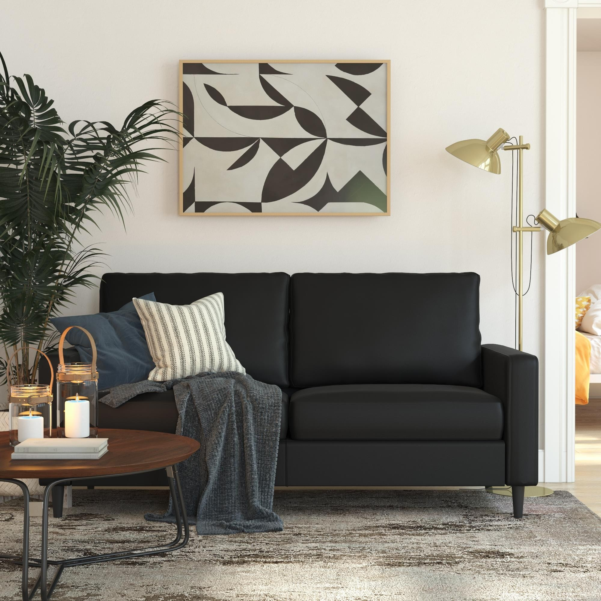 The two-seater black sofa with matching legs and track arms