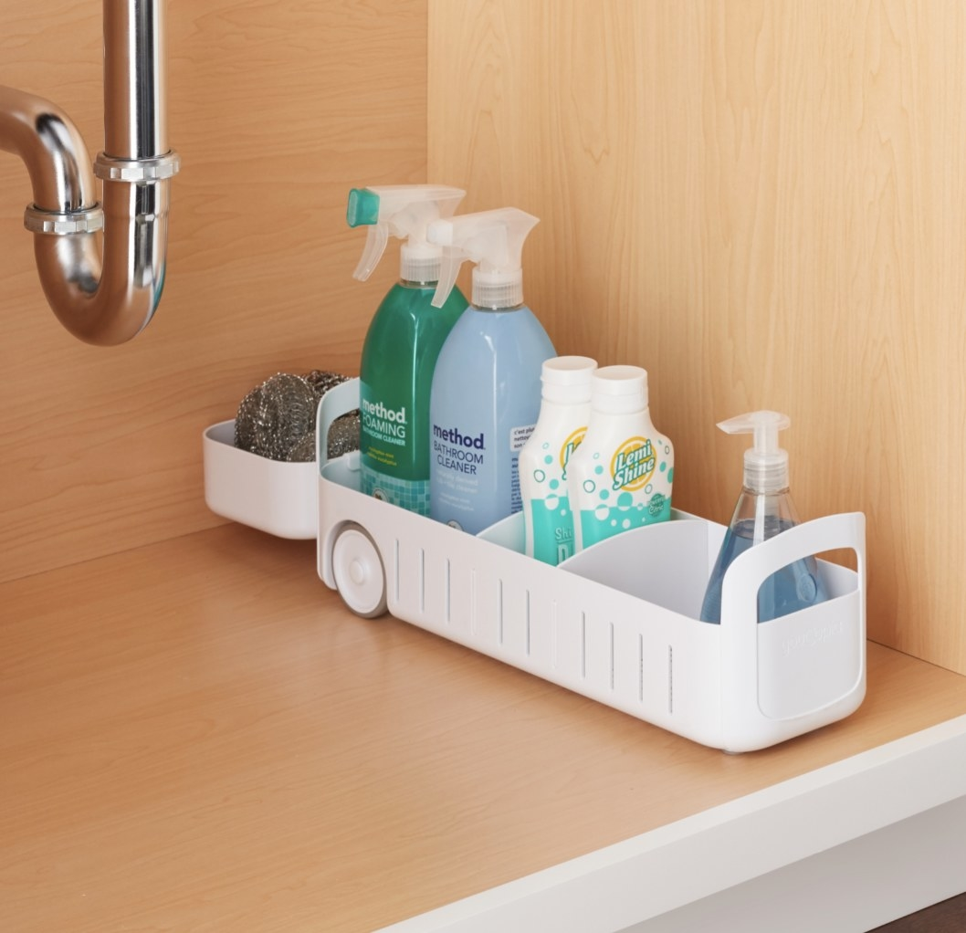 the white caddy holding cleaners and toiletries