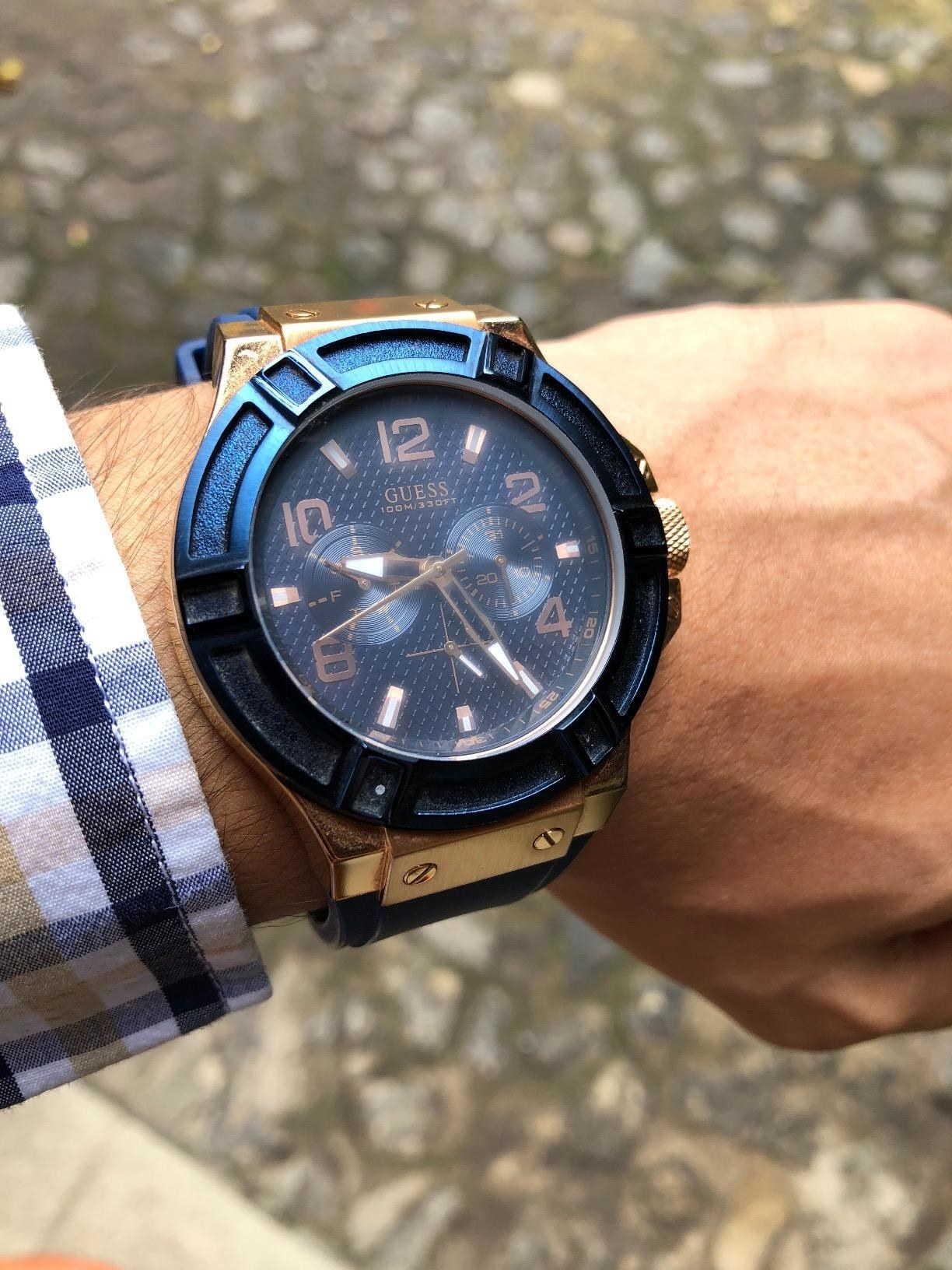 A reviewer wears the watch
