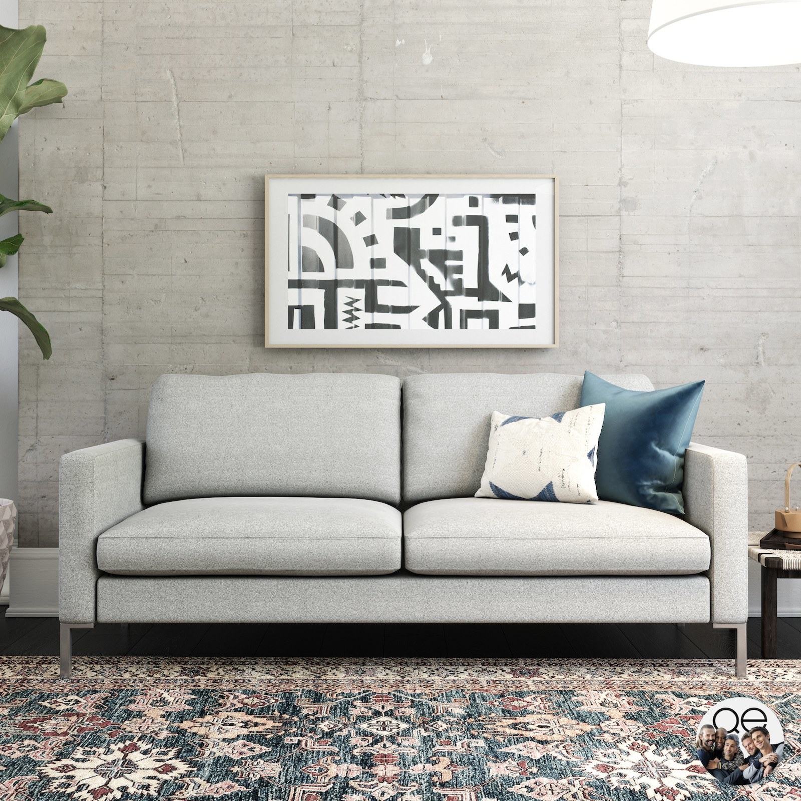 The gray couch with two seat cushions and two back cushions and stainless steel legs in a living room