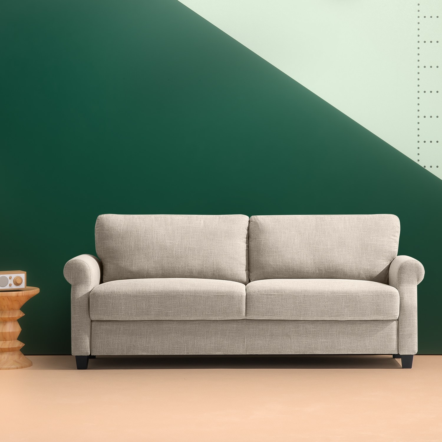 The beige couch with thick cushions and rounded arms