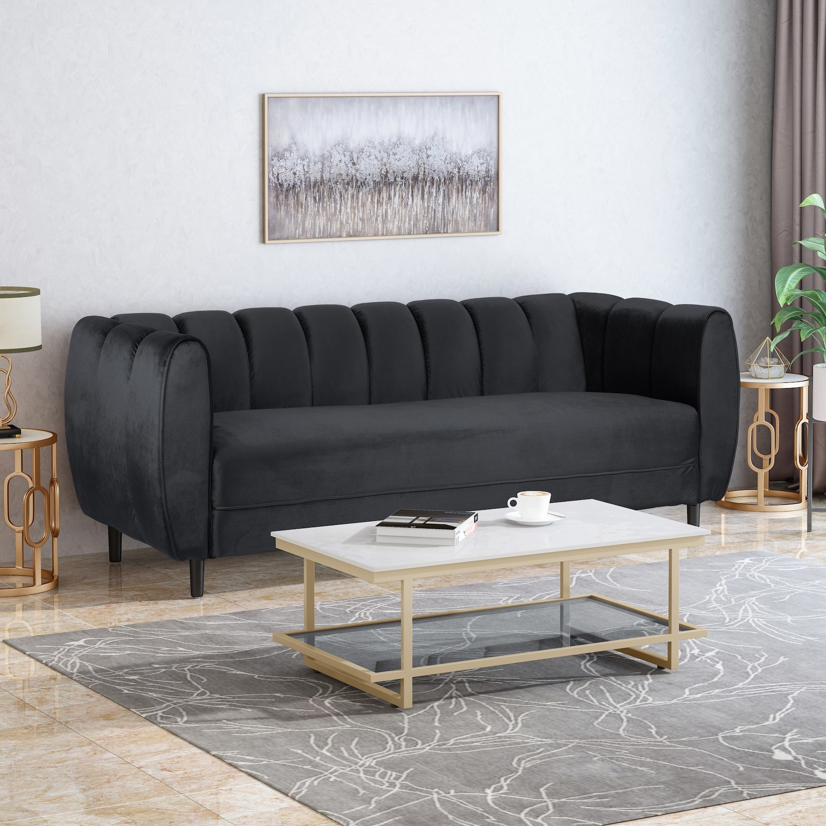 The black velvet couch with a textured back cushion that has vertical lines