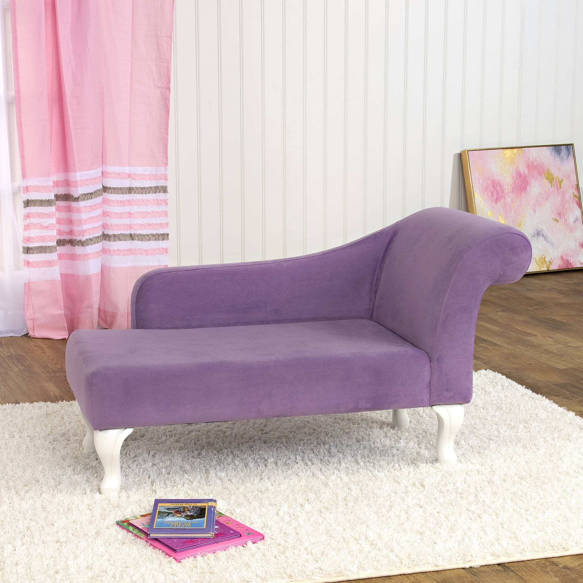 The purple chaise long with white legs in a bedroom