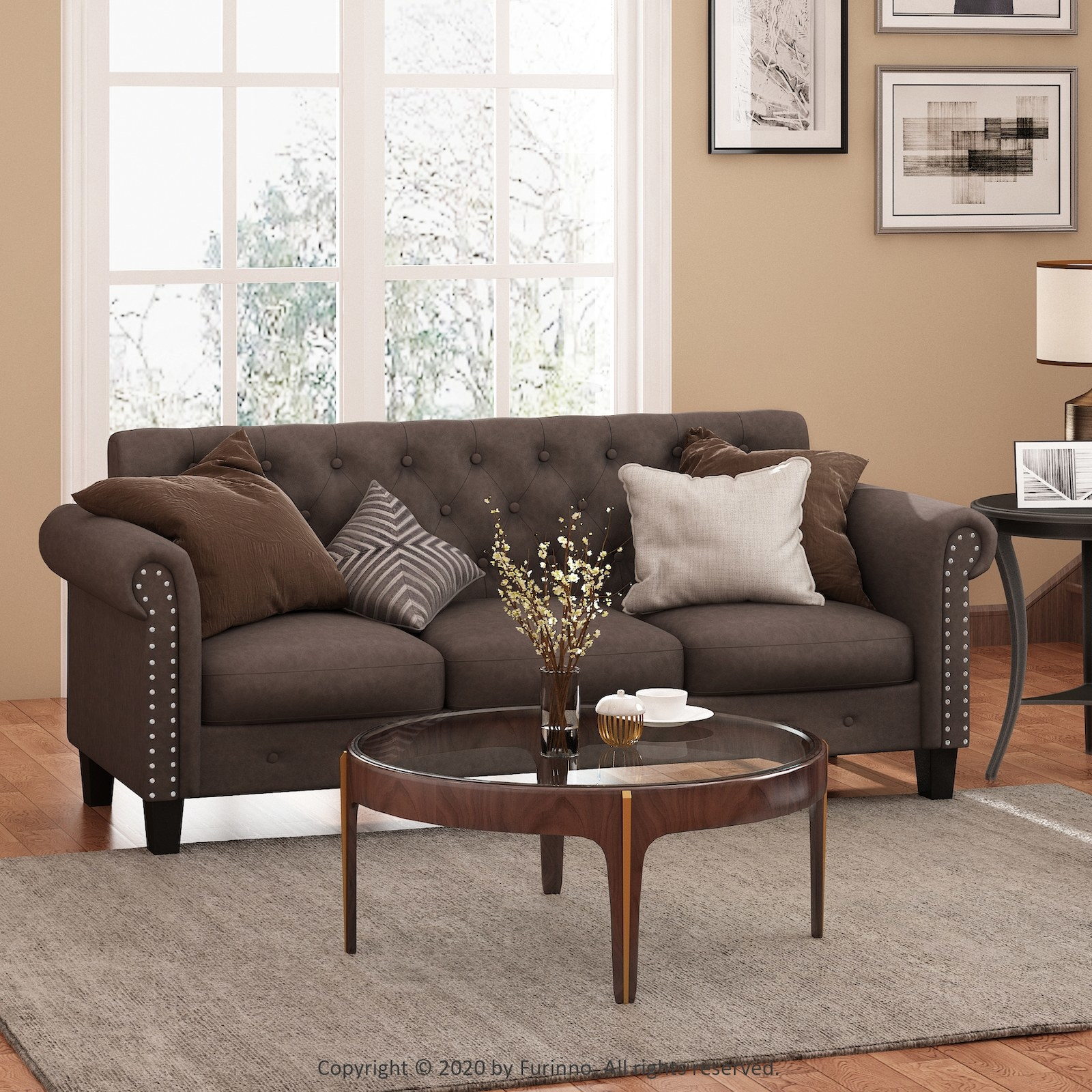 The brown couch with button tufting on the back cushion and nailhead accents on both arms