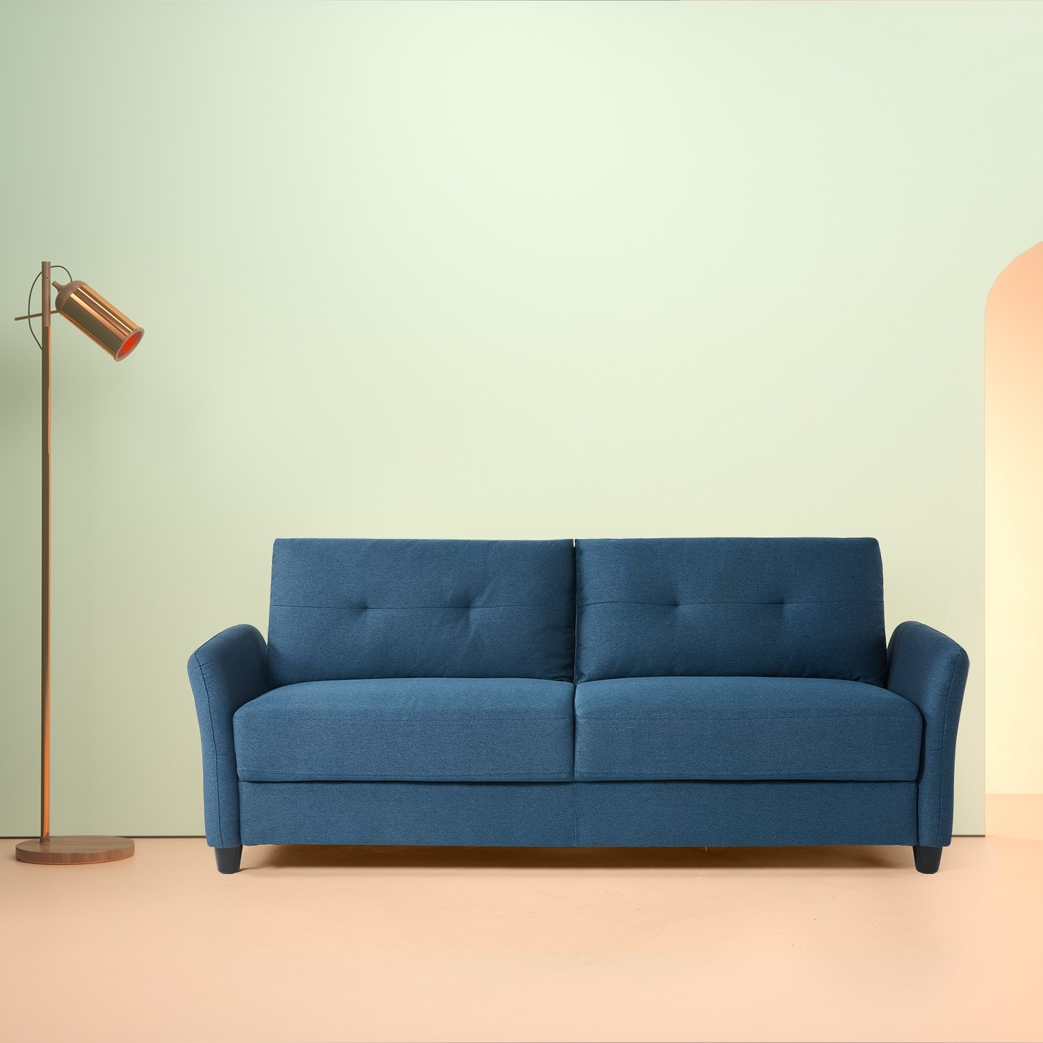 The teal couch with flared arms, plush cushions, and some tufted button detailing on the back