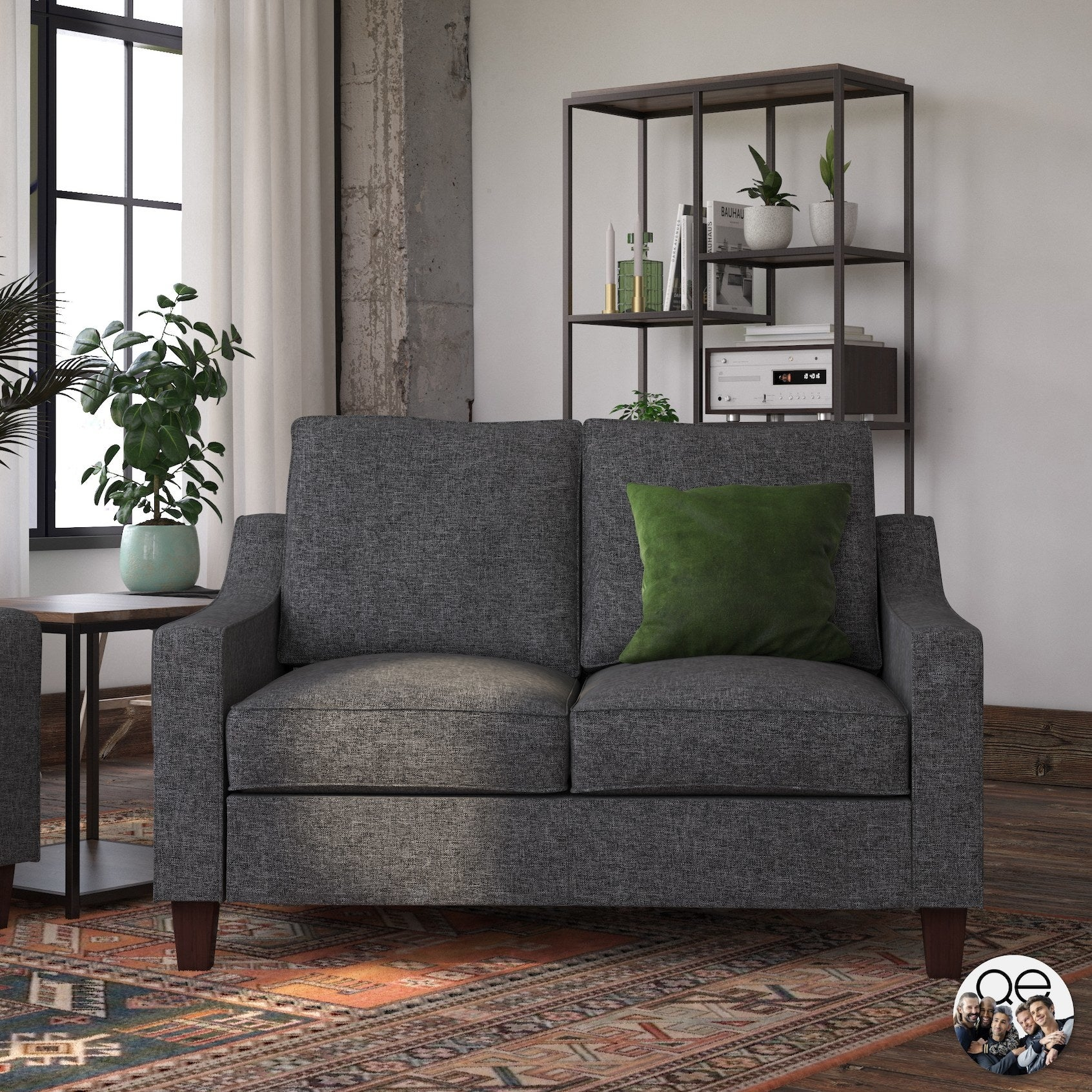 The gray two-seater couch with sleigh arms and wooden legs