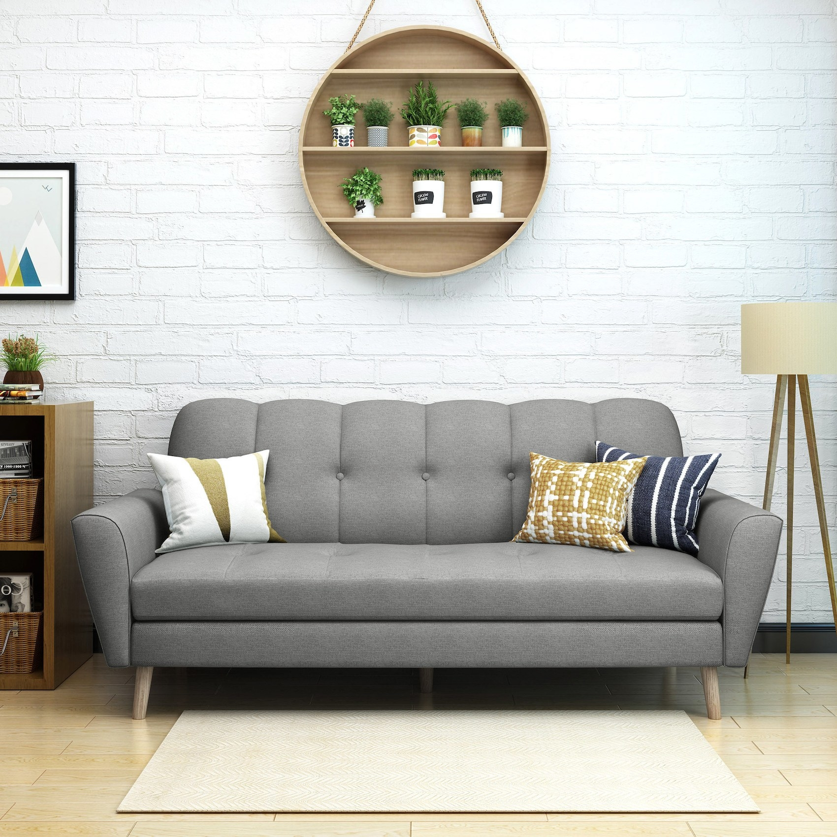 A gray sofa with a curved back and button tufting in a living room