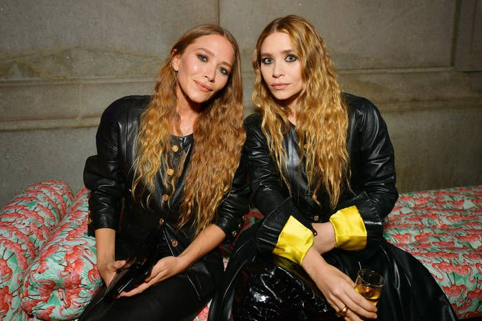 Mary-Kate and Ashley Olsen sit next to each other at the 2019 Met Gala