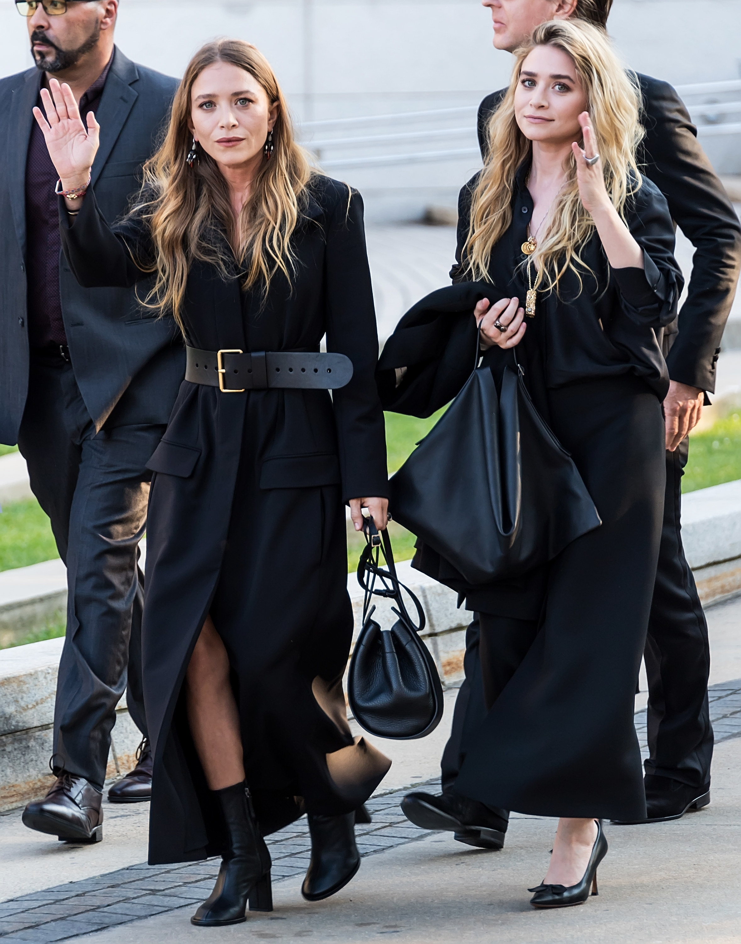Mary-Kate, in a black coat, and Ashley, in a black dress, arrive at the CFDA Fashion Awards in 2018