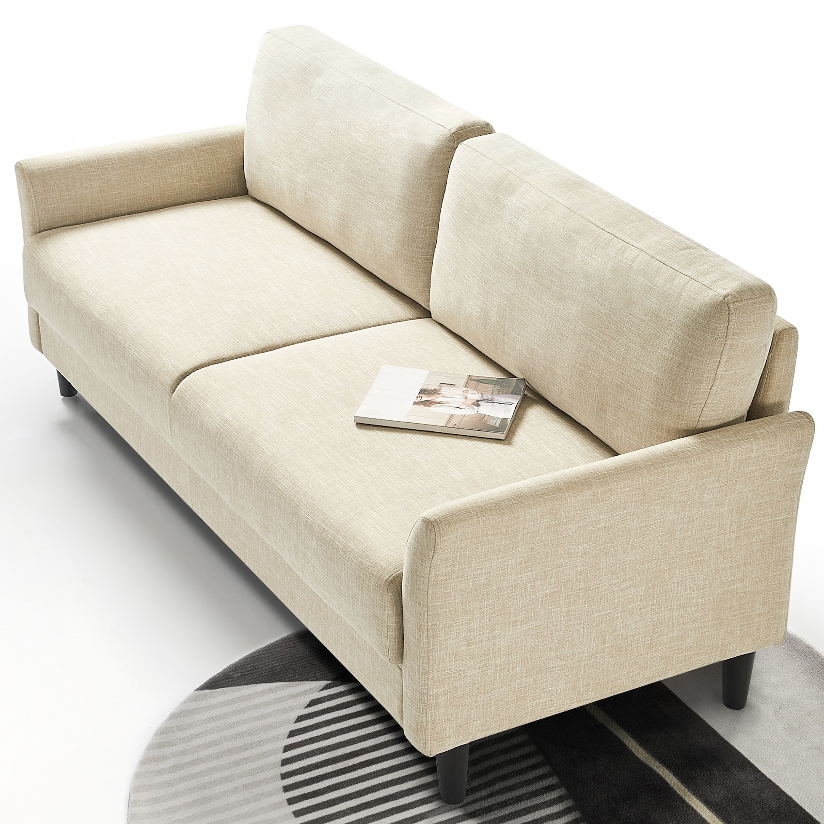 The sofa with flared arms and four cushions in a living room