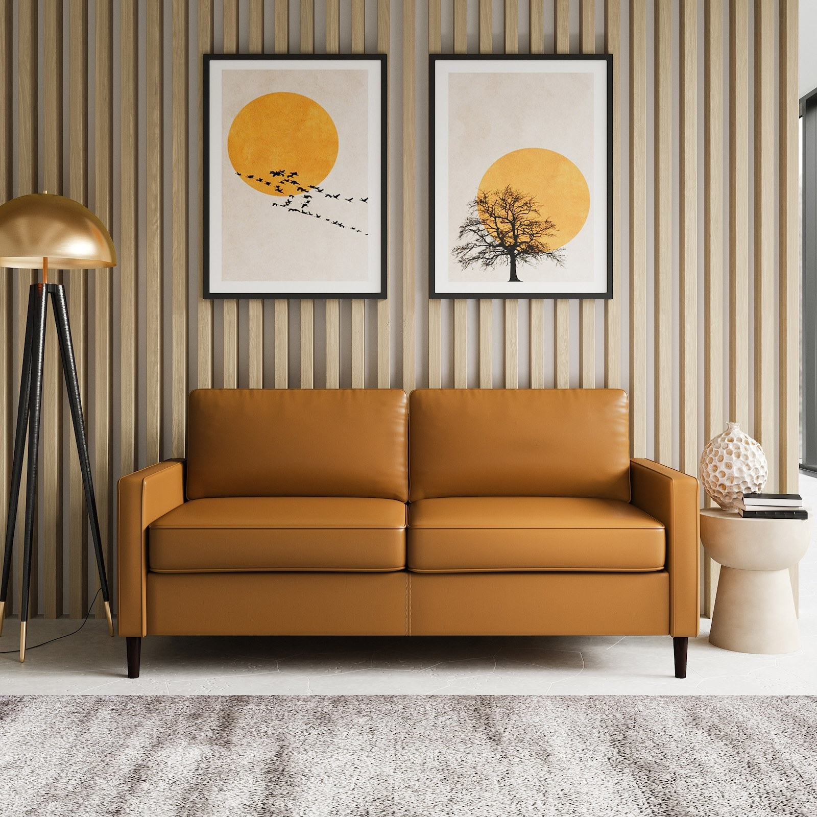 The camel-colored couch with two cushions and piping on each one