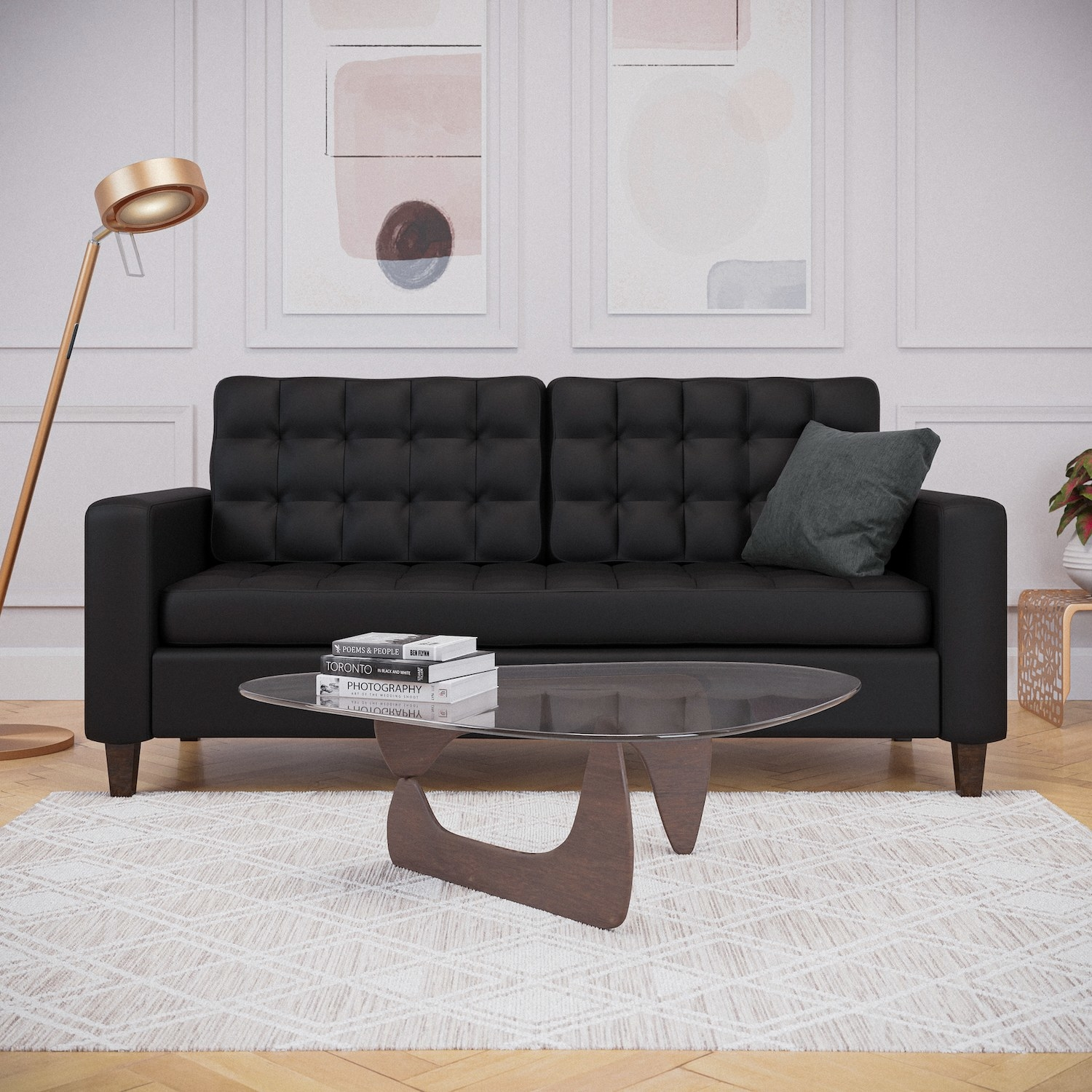 The black sofa with a button tufted seat and back cushion