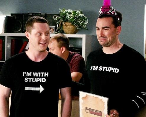 "Patrick wears an ""I'm with Stupid"" tee and David wears an ""I'm stupid"" tee with a tiara"