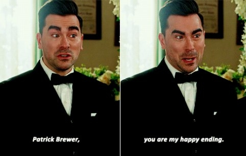 """David says """"Patrick Brewer you are my happy ending"""" while wearing a wedding tux"""
