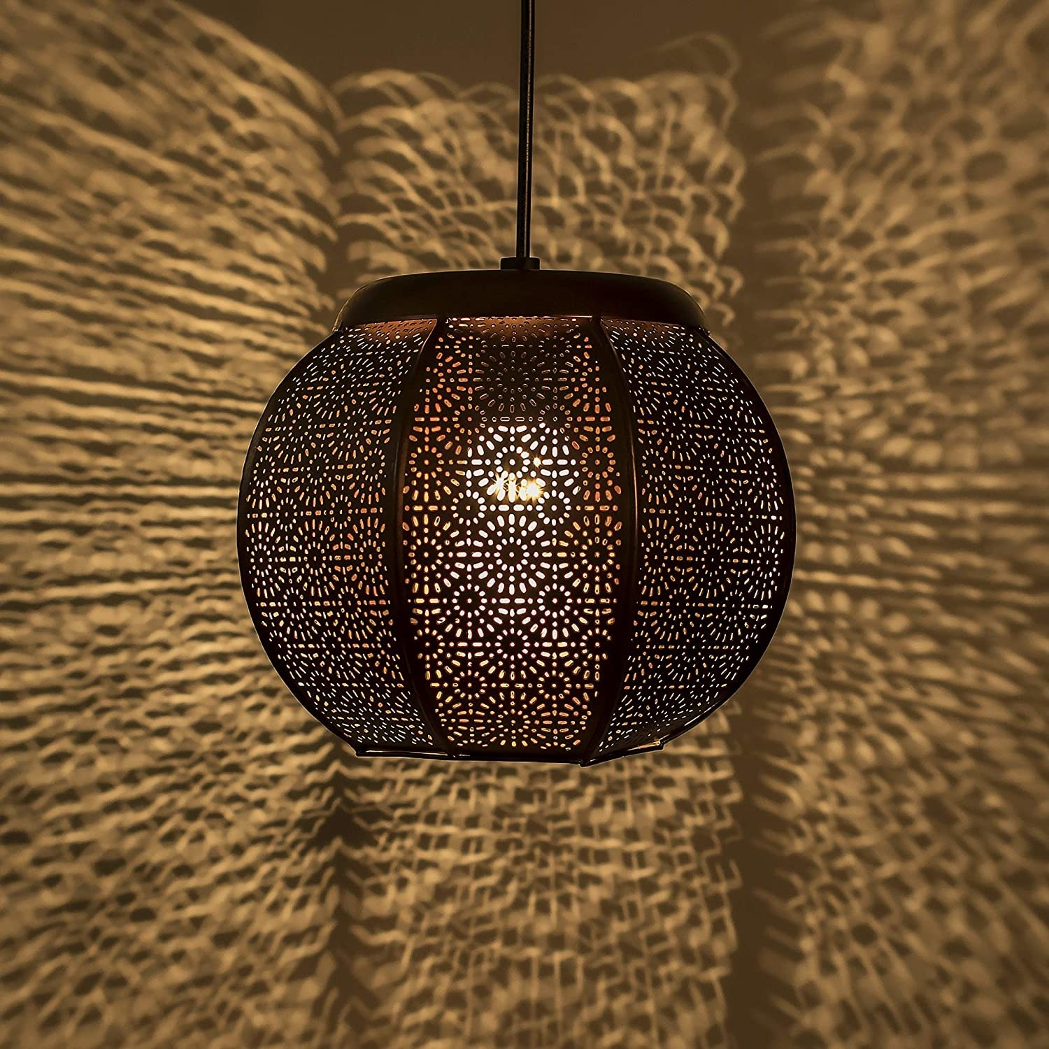 A Moroccan lamp with patterns being cast on walls
