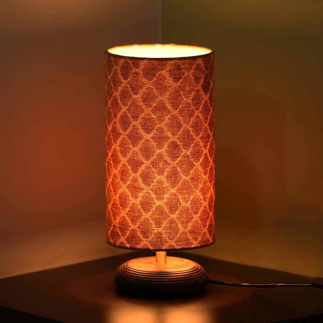 A Mangowood lamp with Moroccan patterns on it