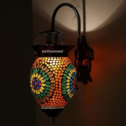 A colorful mosaic lamp on the wall