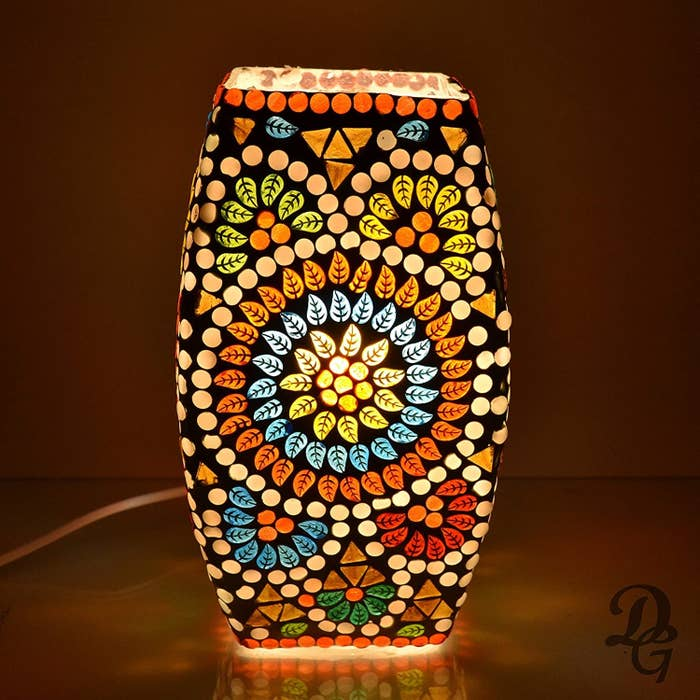 A Turkish mosaic lamp with floral patterns on it