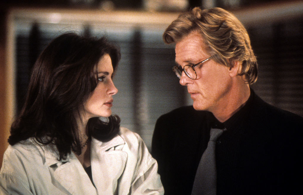 Julia Roberts and Nick Nolte looking at each other miserably in the movie
