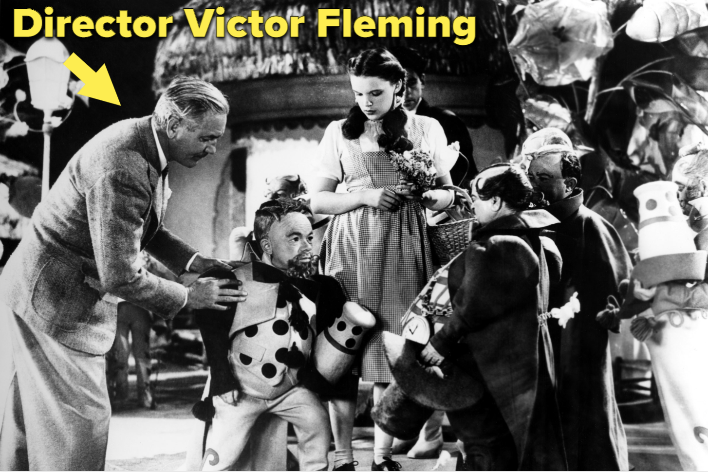 Director Victor Fleming directing Judy Garland and other cast