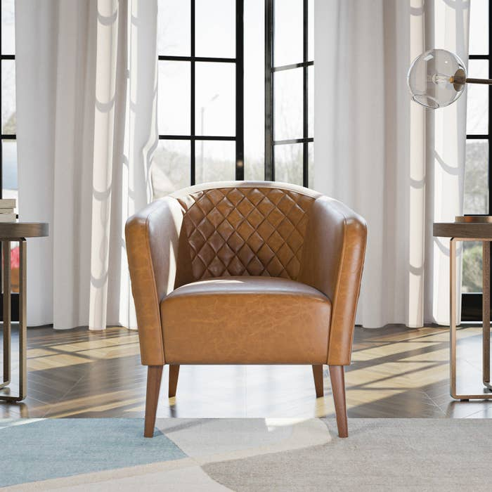 brown faux leather barrel chair with diamond tufted detail