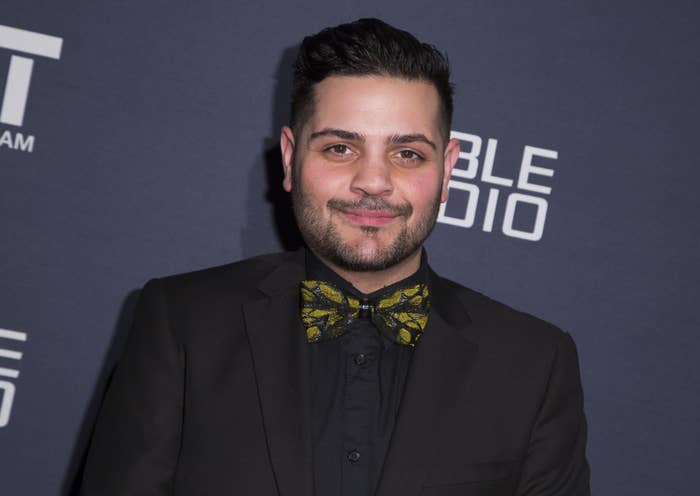 Michael Costello wears a black suit and a black-and-yellow bow tie at a charity event