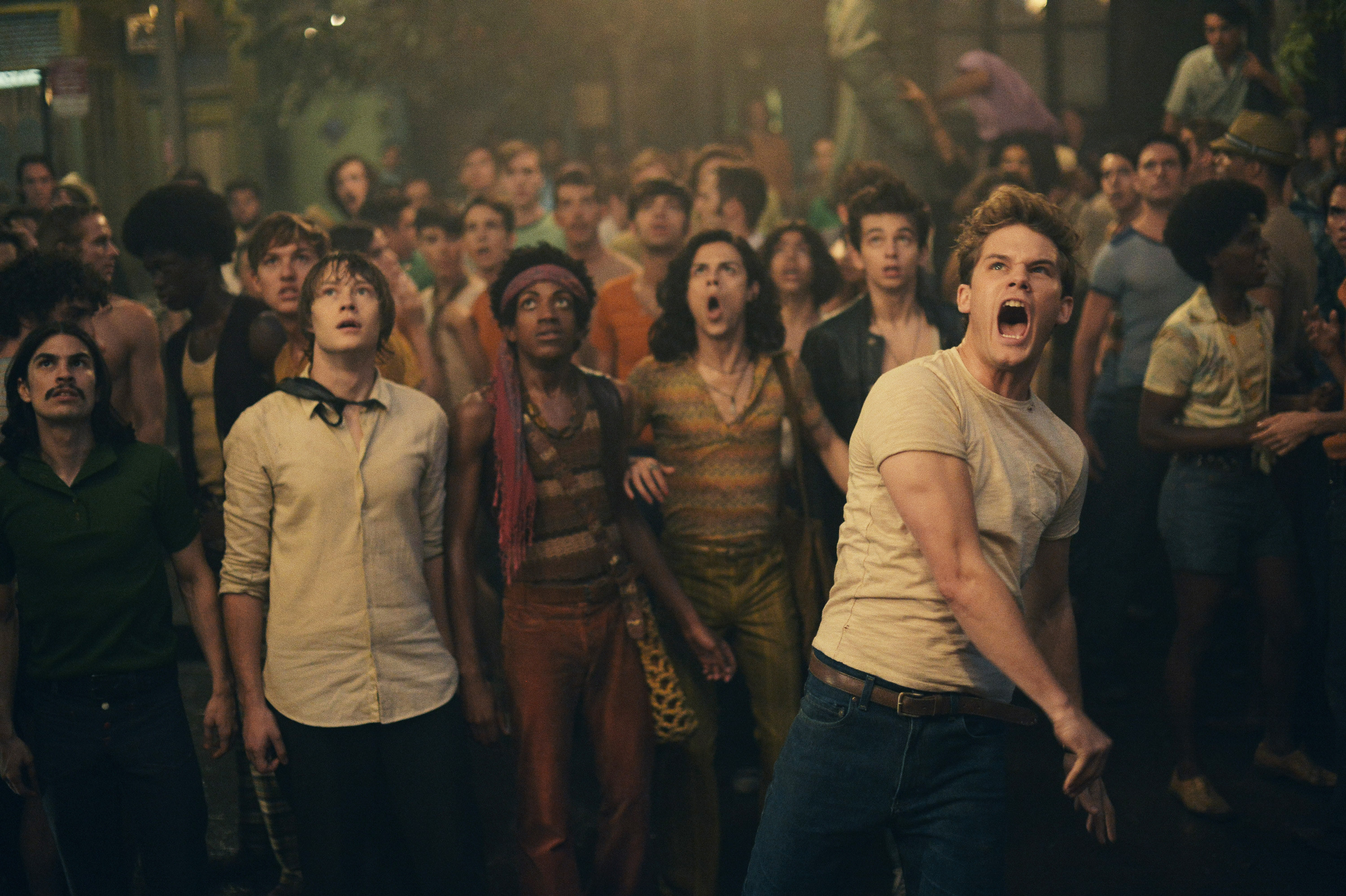 A man yells toward the camera in a scene from Stonewall