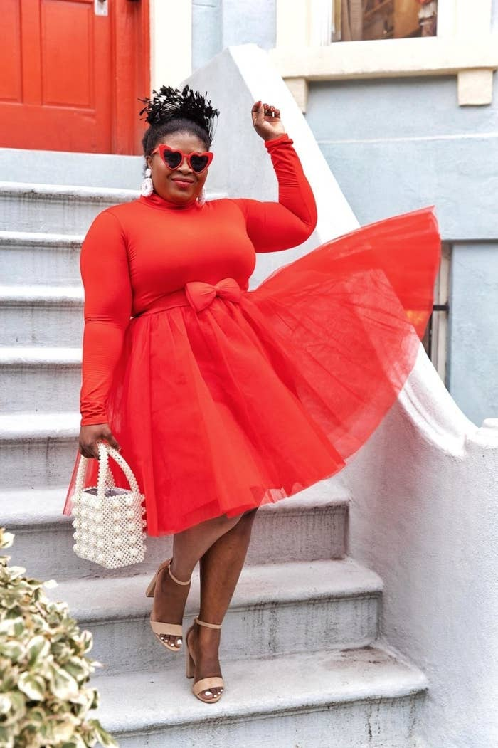 reviewer wearing the red tulle skirt